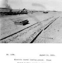 Image of UNRS-P2008-18-3677 - Electric shovel loading gravel. Steam shovel loading gravel in distance. Three trains on circular track of gravel bin circuit. Camera at borrow pit. August 16, 1913.