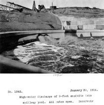 Image of UNRS-P2008-18-3725 - High water discharge of 9 foot conduits into spillway pool. All gates open. Reservoir at elevation 4102. Camera at edge of pool wall and right spillway, left guide wall. January 30, 1914.