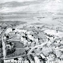 Image of UNRA-P143-03 - Aerial view of the campus: property west of North Virgina Street along left edge of image. (December 8, 1944)