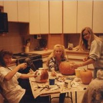 "Image of UNRA-P3367-61 - Halloween Pumpkin Painting for the Hospital's Pediatrics Units. Debbi Lawrence, Jennifer Wilson, Lisa Abfelter. ""Enjoying the Mess!"""