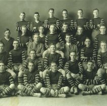 Image of UNRA-P419-1 - The 1914 Nevada rugby football team poses for a photograph. In alphabetical order, the team, including coaches, consisted of: Abbott, Barton, Basil Crowley, Delwyn Dessar, Donovan, Dunkle, Frank Fake, Lehman Ferris, Glascock, Bourke Healey, George Henningsen, Howard, Hill, Jones, Lloyd McCubbin, Joseph McDonald, Harvey McPhail, Martin, Patterson, Root, Ross, Richard Sheehy, Stewart, Archie Trabert, and Walker.