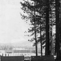 Image of UNRA-P3166-8 - Horseshoe pits beckon campers to play at the 4-H Camp. A casino can be seen in the background.