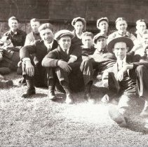 Image of UNRA-P3427-0038 - Unidentified members of the Kappa Lambda fraternity seated on the lawn outside the fraternity house (1927)