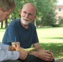 Image of UNRA-P3472-044 - Milt Glick talking with an unidentified man near the Quadrangle (circa 2008).