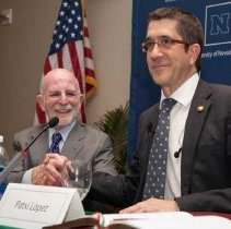 Image of UNRA-P3472-107 - Dr. Milt Glick (president from 2006-2011) sits next to Patxi Lopez, the President of the autonomous Basque Government, at a speaking event.