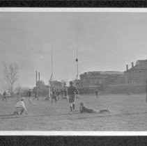 Image of UNRA-P484-029 - Players running toward rugbyball kicked into the air on Mackay Field (ca. 1911)