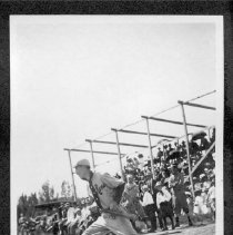Image of UNRA-P484-089 - Baseball player holding bat, with spectators in background (ca. 1911)