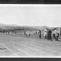 Image of UNRA-P484-111 - Spectators watching track race (ca. 1911)