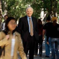 Image of UNRA-P3502-37 - President John Lilley among people on a Quadrangle sidewalk (September 27, 2004)