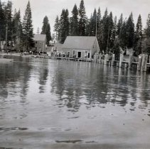 Image of UNRA-P3513-44 - A dock and buildings along the shore of Lake Tahoe (July 18, 1914)