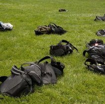 Image of UNRA-P3600-01212 - Photograph of book bags on the lawn during the 2007 Davidson Academys THINK Summer Institute.