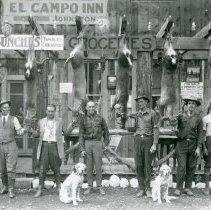 Image of UNRS-P2012-02-042 - El Campo Inn. [Bill Johnston's El Campo Inn. The successful hunt. Reprint.] [[Johnson, 3rd from right]]