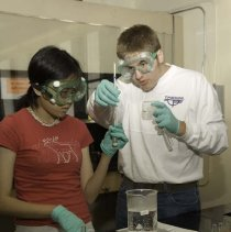Image of UNRA-P3600-01126 - Photograph of two unidentified students doing lab work during the Davidson Academy THINK Camp 2006.