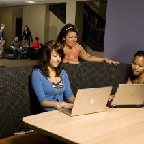 Image of UNRA-P3600-02273 - Students in an @One booth in the Knowledge Center.