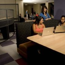 Image of UNRA-P3600-02277 - Students in an @One booth in the Knowledge Center.