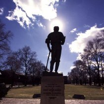 Image of UNRA-P3601-00195 - Photograph of a silhouette of the John Mackay Statue facing quad.