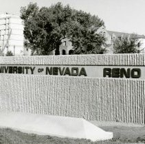 Image of UNRA-P1075-05 - University of Nevada, Reno sign at entrance to campus (1960s)