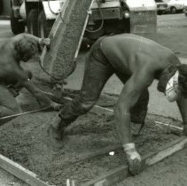 Image of UNRA-P1075-52 - Photograph of close-up of unidentified workmen preparing to pour concrete for a walkway (1960s)