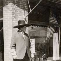 Image of UNRS-P1989-32-6 - Photograph of Jack Wilson, also known as Wovoka, in front of the Lyon County Bank. Caption on image: Jack Wilson Wovoka