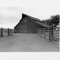Image of UNRS-P2003-13-189 - Photograph of the exterior of a barn with fences in the foreground, Old Cerri Ranch, Paradise Valley. Photograph taken September 16, 2002.