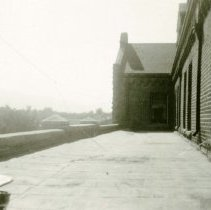 Image of UNRA-P3376-126 - Photograph of Roof of Lincoln Hall, as seen from Room 208. Photos numbered 100 through 161 were removed from a student's WWII era album; original order was maintained.
