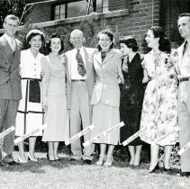 """Image of UNRA-P3376-170 - Photograph of the first group of Harold's Club Scholars to graduate: unidentified man, Jean Nash, """"Pappy"""" Raymond Smith, Ida Bess Sanderson, 2 unidentified students, Mel Winsor. At a reception given by Pappy Smith at Jay (Raymond) Carpenter's house"""