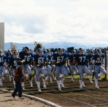 Image of UNRA-P3376-186 - Photograph of Homecoming 1984: University of Nevada, Reno football team on track
