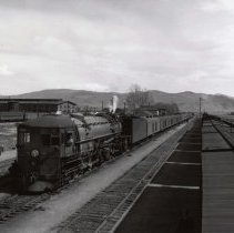 "Image of UNRS-P1988-35-19 - Photograph of Sparks railroad yards, 1939. Southern Pacific railroad buildings and rail yards. Railroad locomotive ""21"" in foreground. Photograph possibly oriented east."