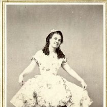 Image of UNRS-P1306-1 - Photograph of an actress in costume posing for the camera. Caption on image: Miss Kathleen O'Neil. In her celebrated Irish character of Kitty from Cork. Virginia, Nevada. October 11th 1867