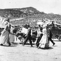 Image of UNRS-P1820-2 - Panoramic photograph of street scene in Ely, Nevada. Caption on image: Pioneers in Ely Nevada. 1926. Compliments of John W. Walker. Electric Studio Ely Nevada.