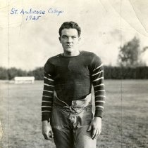 Image of UNRA-P3628-00038 - Photograph of Jake Lawlor in football uniform. Caption on image: St. Ambrose College, 1925.