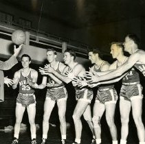 Image of UNRA-P3628-00146 - Photograph of Coach Jake Lawlor and six University of Nevada basketball players. 1948-49-50. Left to right:  Coach Lawlor; Garfinkle; Libke; Hays; Mondive; R. Truman.