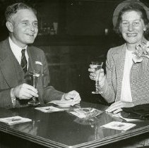 Image of UNRS-P1989-51-693 - [Socialite and Mrs. William L. Barclay, Jr., Scarsdale, N.Y., toast their remarriage here today shortly after Mrs. Barclay divorced W. Ogden Johnson, Bronxville, N. Y..Reno. December 5, 1949.]