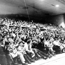 Image of UNRA-P3628-00296 - Photograph of a full house at a basketball game in the Virginia Street Gym, 1957.