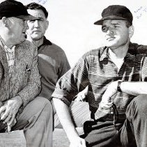 Image of UNRA-P3628-00328 - Photograph of University of Nevada Athletic Director Jake Lawlor and coaches Jim Olivas and Dick Trachok at a track meet in 1959.