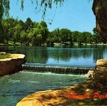 Image of UNRS-P1992-03-0543 - Postcard of weir at Idlewild Park Lake. Caption on image: Idlewild Park, Reno. Caption on verso: Scene in Idlewild Park, Reno, Nevada. One of many delightful recreational areas, that contribute to the scenic beauty of Reno. [ca. 1960]