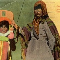 Image of UNRS-P1992-03-0562 - Two copies of postcard containing image of woman holding child in papoose. Caption on image: Nevada Squaw and Papoose, Reno, Nevada. Handwritten on copy 2: Susie Rowe and daughter Louise. Susie Rowe is mother of Katie Frazier. Identified by Katie. [ca. 1920]