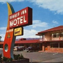 Image of UNRS-P1992-03-0709 - Postcard of sign in front of Donner Inn Motel. Caption on verso: Donner Inn. Motel and Rock Shop. Reno, Nevada. Heated pool - air cooled - tile showers and tubs - room phones - T.V. - radios - coffee - ironing board. Adjacent - restaurant - shopping center - lounge - laundry. Member of Best Western - AAA - All-State Motor Club - Close in. Marge and Joe Fischer. [ca. 1967]