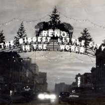 Image of UNRS-P1992-03-0876 - Postcard containing photograph of lights hung on the Reno Arch. [ca. 1929]