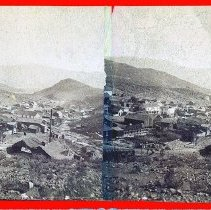 Image of UNRS-P0193-2 - Photograph of Silver City, Nevada. Caption on image: Silver City, Nev. 1874. [Buildings in Silver City, Nevada]