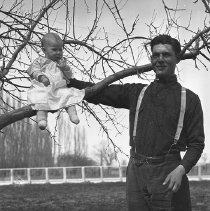 Image of UNRS-P1984-23-094 - Negative only. Luetta and Daddy [Fred Dressler] in the apple tree. [ca. 1922]. Photo by Anna Dressler.
