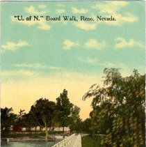 """Image of UNRS-P1992-03-1354 - Image of the University of Nevada, Reno's wooden walkway, """"tram"""". In this image, Manzanita Lake is visible. Trees, a dirt path, and a white board walk can also be seen. A red building can be seen on the left side of the image which is partially obscured by a tree. Caption on image front: """"U. of N."""" Board Walk, Reno, Nevada. Handwritten note on verso: """"Reno[,] Nev. June 10, 1917. Dear cousin, your card received sometime ago so will write a few lines today. Arthur and Genevieve have been with us for several weeks but they expect to leave for Colo. this week. Arthur is to be Educational Superintendent in the Inter- Mountain Conf. I hate to have them go so far away but I guess it is all for the best. I was surprised to hear of Uncle Walter selling out and going to Portland. Do they live near you? We have had a few days of warm weather but it is cooler today. We are going to have C.M. here the last of this month. Lovingly Myrtle.""""  Addressed to: Mrs. James Fry, 442 E. 8 St., Portland, Oregon. Postmarked 1917."""