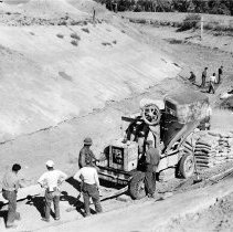 Image of UNRS-P2008-18-0372 - [Civilian Conservation Corp]. Project Manager W. Wallace inspecting work on canal lining in 1938.
