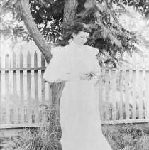 Image of UNRS-P2618-1 - Photograph of Bessie Tahoe Doten standing under tree.