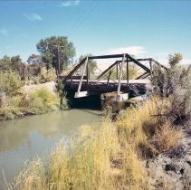 Image of UNRS-P2008-18-0915 - [TCID District Canals 1966]. Truckee-Carson Irrigation District. First bridge below the Carson River Diversion on the T-Canal. This structure (classified as a county bridge) is in very deteriorated condition. October 11, 1966.