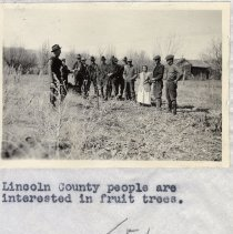 Image of UNRA-P1749-0051 - Group of unidentified Lincoln County people near fruit trees (1922)