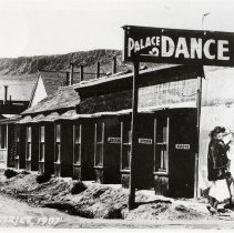 Image of UNRS-P1878-1 - Photograph of exterior of Palace Dance Hall, a brothel. Caption on image: Red Light District 1907. Handwritten on verso: Red light district 1907 - Goldfield, Nev.?