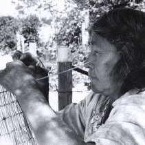 Image of UNRS-P1989-32-0194 - Nina Dunn making baby basket.