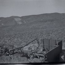 Image of UNRS-P2003-02-063 - Negative. Caption on original envelope: Groom, January 17, 1917, Shaw's camera; Groom, January-March 1917; [addressed to] T. J. Osborne, Groom Mine, Nevada via Las Vegas. [Men in partially constructed building]