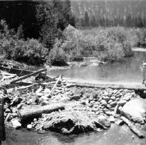 Image of UNRS-P2008-18-2141 - [B_W photos- Donner Lake circa 1928]. Photo taken June 24, 1928 by D.S. Str[?]. Donner Lake Outlet. Looking upstream. Temporary earth and rock fill dam immediately above new concrete dam.